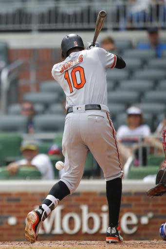 Baltimore Orioles' Adam Jones (10) is hit by a pitch in the eighth inning of a baseball game against the Atlanta Braves, Sunday, June 24, 2018, in Atlanta. (AP Photo/Todd Kirkland)