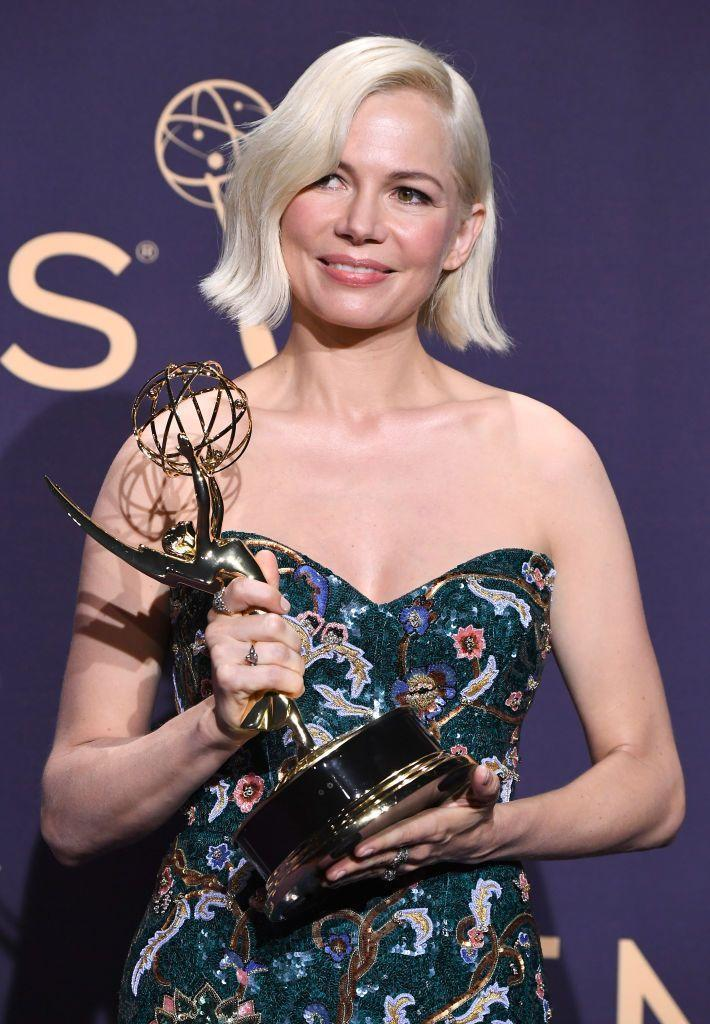 """<p>This ultra-white shade <strong>Michelle Williams</strong> is sporting takes platinum blonde to the next level. The almost-silver hair color is trending all over Instagram as of late (blame Daenerys Targaryen). Make sure you grab some<a href=""""https://www.goodhousekeeping.com/beauty/g26817422/best-purple-shampoos/"""" rel=""""nofollow noopener"""" target=""""_blank"""" data-ylk=""""slk:purple shampoo to maintain this icy hue"""" class=""""link rapid-noclick-resp""""> purple shampoo to maintain this icy hue</a>.</p>"""