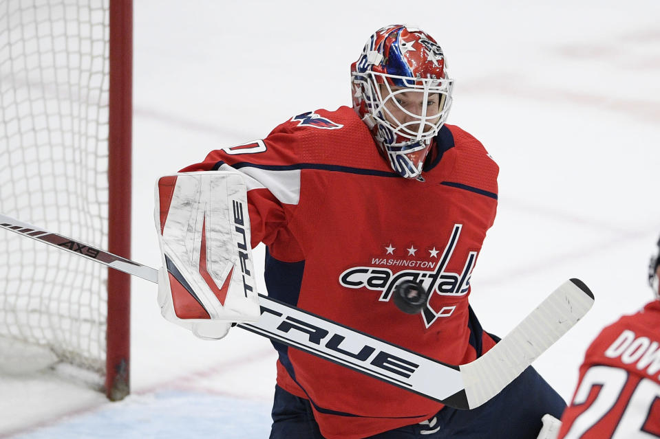 Washington Capitals goaltender Ilya Samsonov stops the puck during the second period of the team's NHL hockey game against the Philadelphia Flyers, Tuesday, April 13, 2021, in Washington. (AP Photo/Nick Wass)