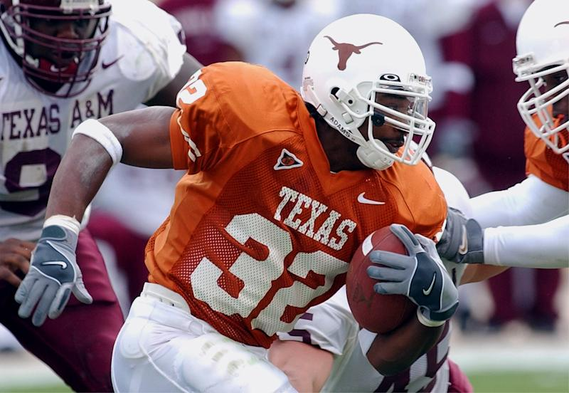 Texas running back Cedric Benson rushes for a three-yard gain during second quarter action against Texas A&M on Friday, Nov. 29, 2002, in Austin, Texas. (AP Photo/Harry Cabluck)