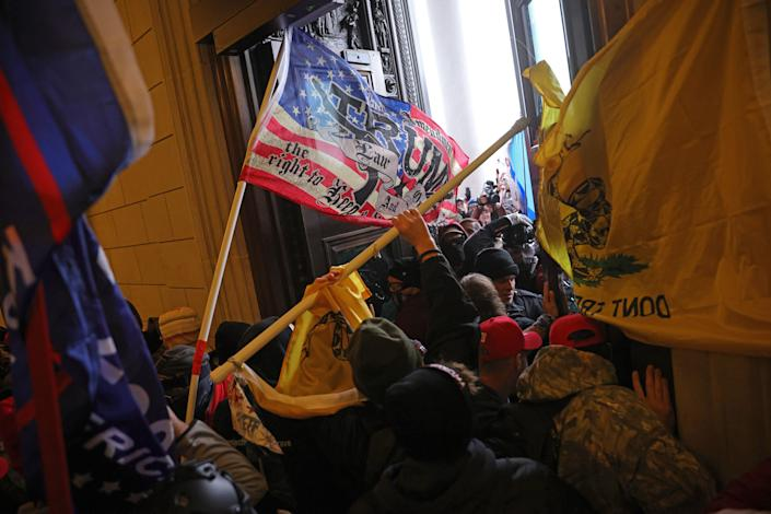 A violent mob of Trump supporters break into the U.S. Capitol on Jan. 6. (Win McNamee/Getty Images)