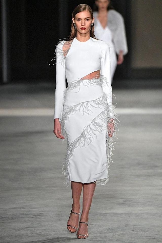 <p>A white cutout dress with feather details at the Cushnie et Ochs FW18 show. (Photo: Getty) </p>