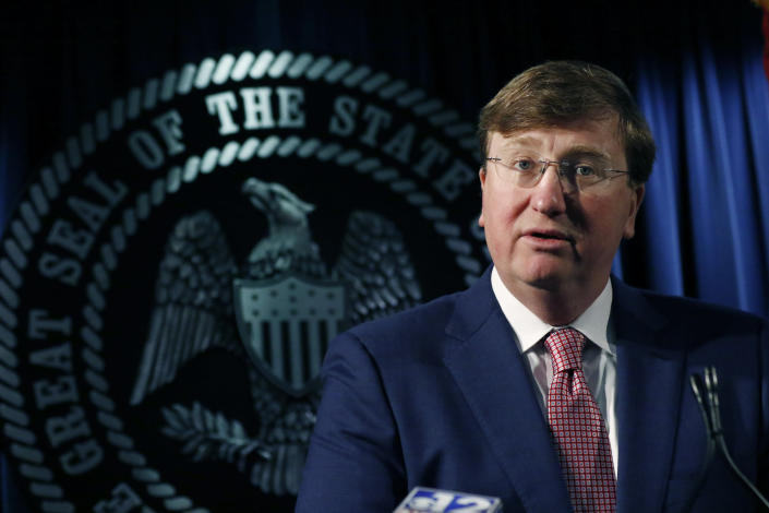 Republican Gov. Tate Reeves speaks with reporters on a variety of issues, including the state prison system and the state auditor's office investigation of the former director of Mississippi's welfare agency and four other people, accused of embezzling millions in federal money meant for the poor, Thursday, Feb. 6, 2020, in Jackson, Miss. (AP Photo/Rogelio V. Solis)