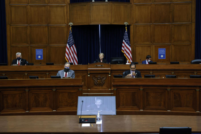 House Oversight and Reform Committee Chairwoman Carolyn Maloney, D-N.Y., seated center and on screen, speaks during a House Oversight and Reform Committee regarding the on Jan. 6 attack on the U.S. Capitol, on Capitol Hill in Washington, Wednesday, May 12, 2021. (Jonathan Ernst/Pool via AP)