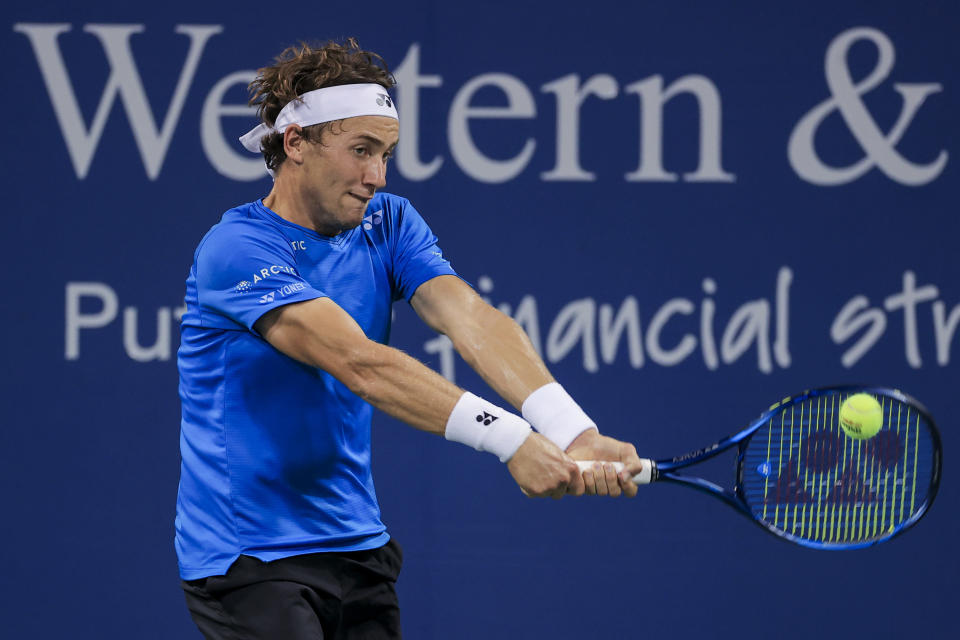 Casper Ruud, of Norway, returns to Alexander Zverev, of Germany, during the Western & Southern Open tennis tournament Friday, Aug. 20, 2021, in Mason, Ohio. (AP Photo/Aaron Doster)