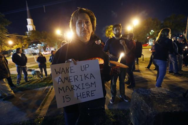 <p>Dana Farley of New Orleans participates in a candlelight vigil at the statue of Jefferson Davis in New Orleans, Mon., April 24, 2017.(Photo: Scott Threlkeld/AP) </p>