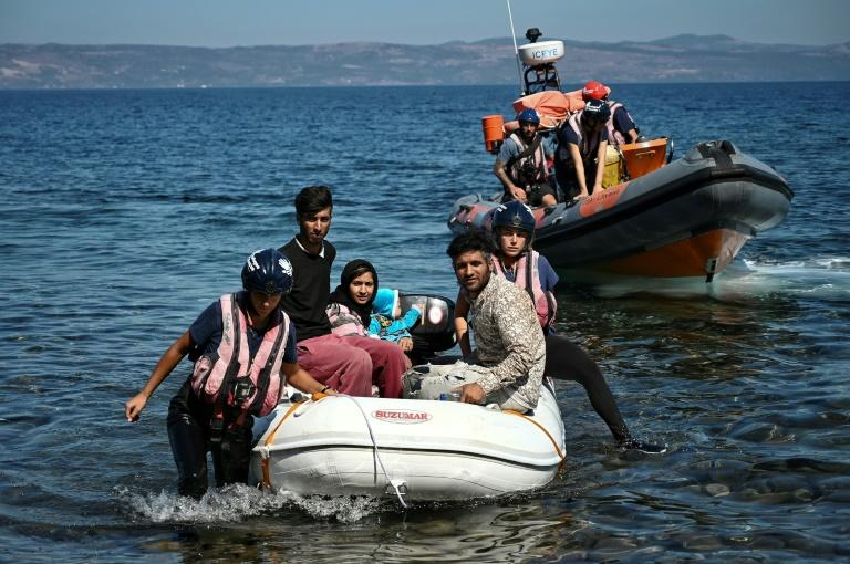 Migrants helped by rescuers arrive on the Greek island of Lesbos after crossing the Aegean Sea from Turkey, on September 16, 2019