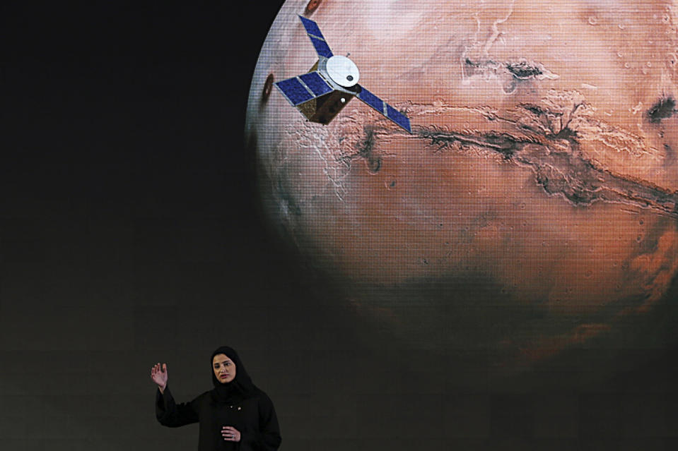 "FILE - In this Wednesday, May 6, 2015 file photo, Sarah Amiri, deputy project manager of the United Arab Emirates Mars mission, talks about the project named ""Hope,"" or ""al-Amal"" in Arabic, which is scheduled for launch in 2020, during a ceremony in Dubai, UAE. Three countries — the United States, China and the United Arab Emirates — are sending unmanned spacecraft to the red planet in quick succession beginning in July 2020. (AP Photo/Kamran Jebreili, File)"