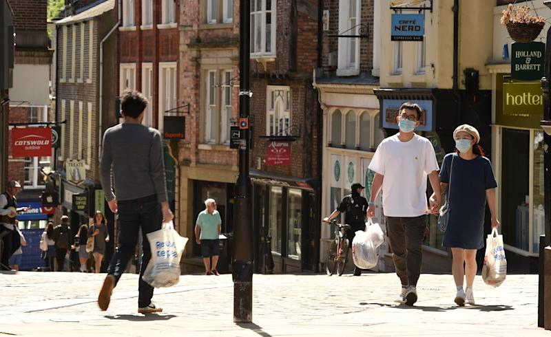 People walk in the sunshine in Durham, north east England, where 10 Downing Street special advisor Dominic Cummings is alleged to have travelled to, from London, while the nation was under lockdown to curb the spread of COVID-19. - British Prime Minister Boris Johnson on Monday failed to draw a line under a scandal over his top aide Dominic Cummings allegedly breaching coronavirus rules as pressure mounted on the Brexit mastermind to go. Cummings is alleged to have left his London home to stay with his parents in Durham, northeast England, while suffering symptoms of COVID-19, British newspapers the Daily Mirror and The Guardian said. (Photo by Oli SCARFF / AFP) (Photo by OLI SCARFF/AFP via Getty Images)