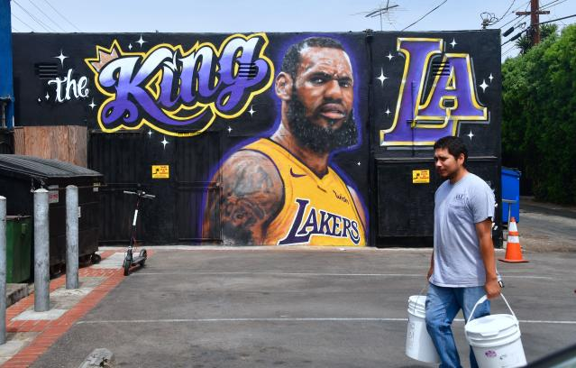 "In Los Angeles, freshly painted <a class=""link rapid-noclick-resp"" href=""/nba/players/3704/"" data-ylk=""slk:LeBron James"">LeBron James</a> murals became a target for longtime <a class=""link rapid-noclick-resp"" href=""/ncaaf/players/285862/"" data-ylk=""slk:Kobe Bryant"">Kobe Bryant</a> supporters unhappy about the arrival of a player they have long vilified. (Getty Images)"
