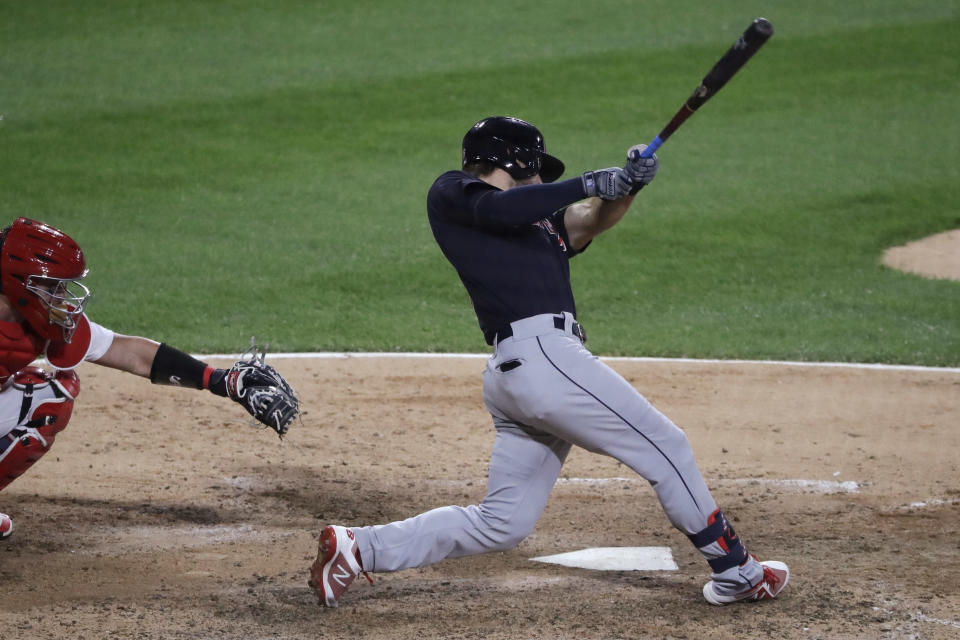 Cleveland Indians' Mike Freeman hits an RBI single against the Chicago White Sox during the 10th inning of a baseball game in Chicago, Sunday, Aug. 9, 2020. (AP Photo/Nam Y. Huh)