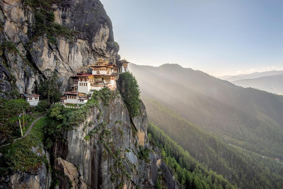 """This Buddhist monastery and temple, also known as """"The Tiger's Nest,"""" sits perilously on a cliff, 900 meters (2,952 feet) above the Paro Valley in <a href=""""https://www.cntraveler.com/galleries/2016-05-09/beautiful-images-of-bhutan-the-worlds-happiest-country?mbid=synd_yahoo_rss"""" rel=""""nofollow noopener"""" target=""""_blank"""" data-ylk=""""slk:Bhutan"""" class=""""link rapid-noclick-resp"""">Bhutan</a>, making it worth a trip for the views alone. Taktsang was built in 1692, at the site of a cave where Guru Rinpoche—or second Buddha—meditated for """"three years, three months, and three hours"""" to ward off evil. The site has been sacred ever since, and you can reach it via a steep, two-hour climb from the valley. Once you get to the temple, you can explore the grounds after removing your shoes."""