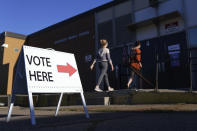 Voters arrive to cast their ballots at Northeast Middle School in Minneapolis, Minnesota, during the first election in Minnesota since the full outbreak of the COVID-19 pandemic, Tuesday, Aug. 11, 2020. (Anthony Souffle/Star Tribune via AP)