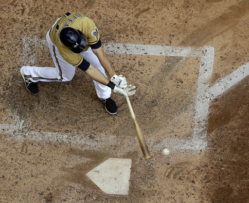 Milwaukee Brewers' Jeff Bianchi hits a two-run scoring single during the sixth inning of a baseball game against the Washington Nationals Sunday, Aug. 4, 2013, in Milwaukee. (AP Photo/Morry Gash)