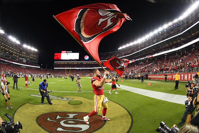 San Francisco 49ers defensive end Nick Bosa (97) waves a 49ers flag after beating the Browns on Monday night. (Getty Images)
