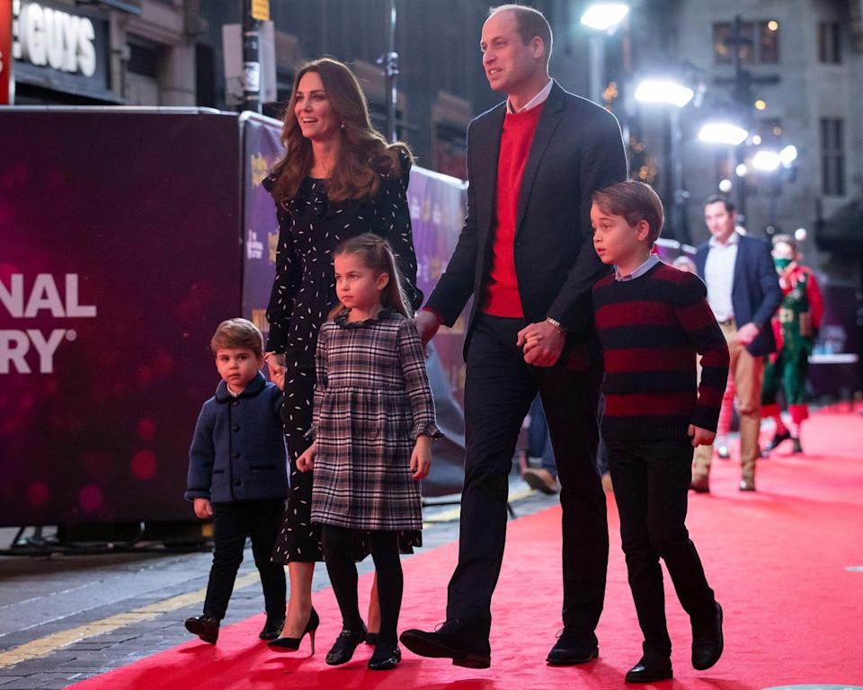 Prince William and Duchess Kate with their children, Prince Louis, Princess Charlotte and Prince George, at a pantomime performance at London's Palladium Theatre on Dec. 11, 2020, to thank key workers and families for their efforts during the COVID-19 pandemic.