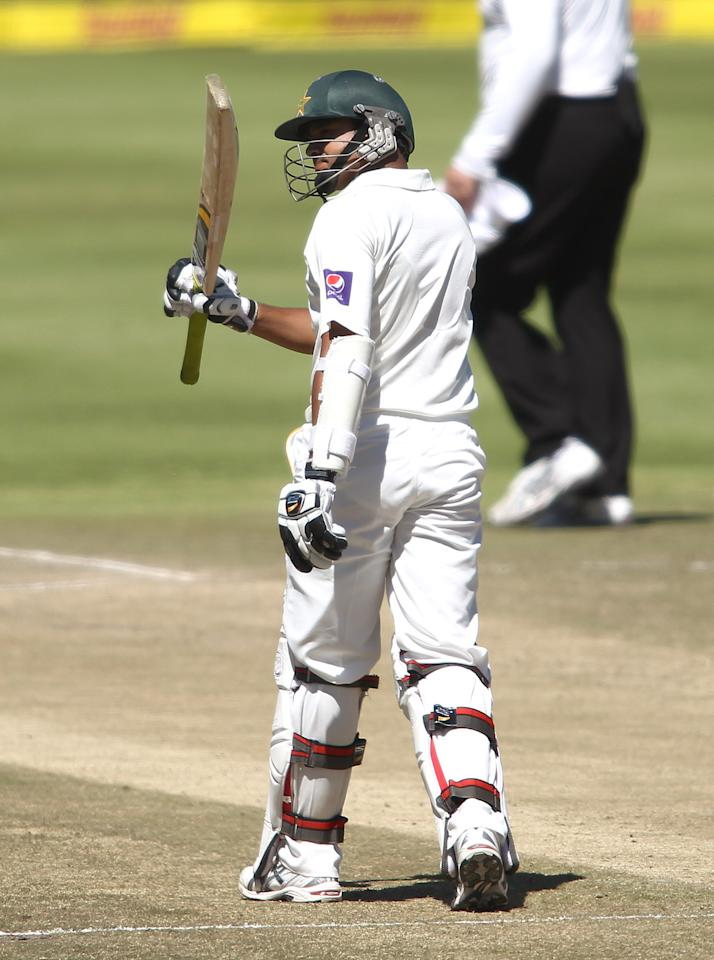 CAPE TOWN, SOUTH AFRICA - FEBRUARY 17:  Azhar Ali of Pakistan raises his bat after reaching his fifty during day 4 of the 2nd Sunfoil Test match between South Africa and Pakistan at Sahara Park Newlands on February 17, 2013 in Cape Town, South Africa. (Photo by Shaun Roy/Gallo Images/Getty Images)