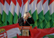 FILE - In this Friday, April 6, 2018 file photo, Prime Minister Viktor Orban pauses while delivering a speech during the final electoral rally of his Fidesz party in Szekesfehervar, Hungary. When Hungary and Poland joined the European Union in 2004, after decades of Communist domination, they thirsted for Western democratic standards and prosperity. Yet 17 years later, as the EU ramps up efforts to rein in democratic backsliding in both countries, some of the governing right-wing populists in Hungary and Poland are comparing the bloc to their former Soviet oppressors — and flirting with the prospect of exiting the bloc. (AP Photo/Darko Vojinovic, File)