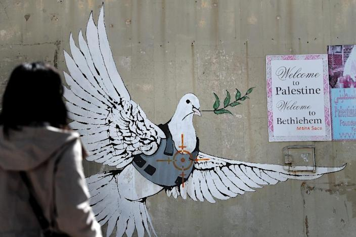 Street art by Banksy shows a dove with a bulletproof vest near his hotel in the occupied West Bank town of Bethlehem (AFP Photo/THOMAS COEX)