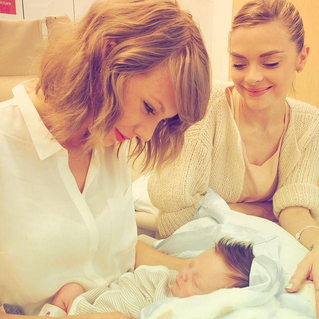 """<p>In 2015, the actress shared her first photo of her second son, little Leo Thames, with his godmother Taylor Swift. </p><p>The friends shared the singer's first meeting with the newborn, with the Pearl Harbour star captioning the photo: 'My loves meet. Baby boy Leo Thames and his God Mother = Bliss. X.'</p><p><a href=""""https://www.instagram.com/p/5sheJYt1HJ/?utm_source=ig_web_copy_link"""" rel=""""nofollow noopener"""" target=""""_blank"""" data-ylk=""""slk:See the original post on Instagram"""" class=""""link rapid-noclick-resp"""">See the original post on Instagram</a></p>"""
