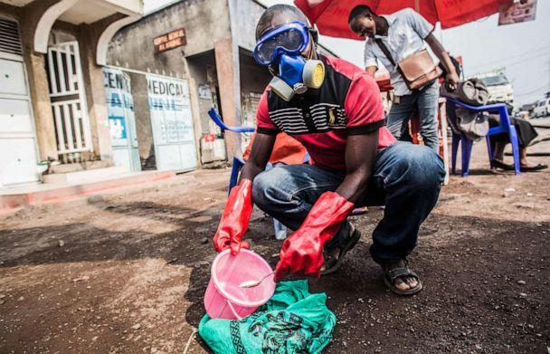 PHOTO: A health worker wears protective gear and mixes water and chlorine in Goma on July 31, 2019. (Pamela Tulizo/AFP/Getty Images)