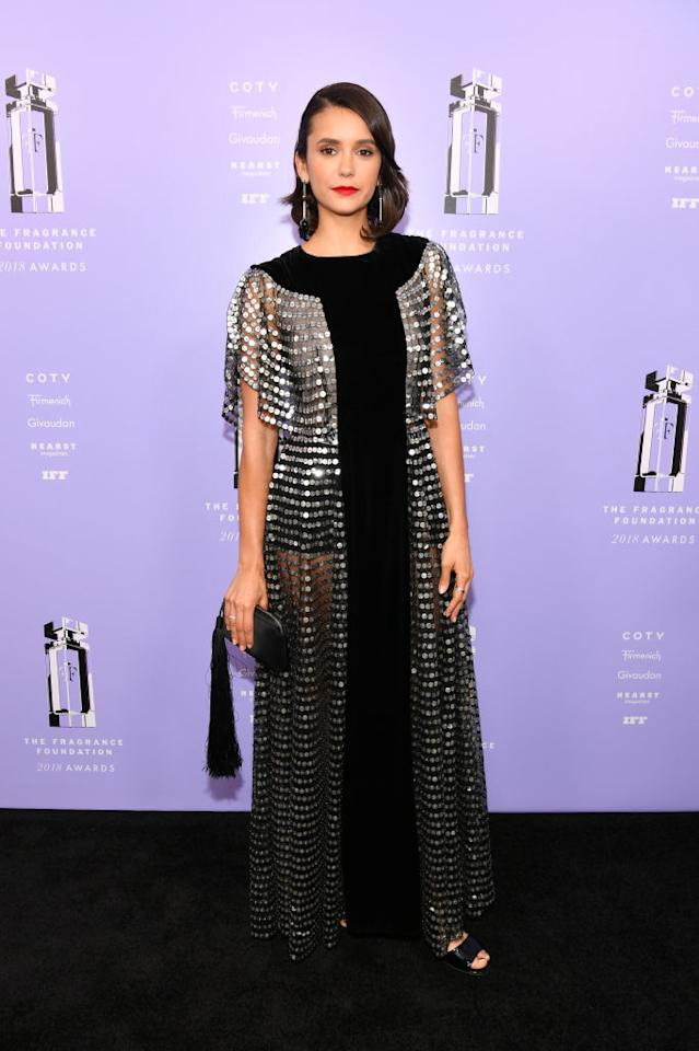 <p>Nina Dobrev wears a sheer silver and black paneled Dior dress to the 2018 Fragrance Foundation Awards in New York City on June 12, 2018. (Photo: Dia Dipasupil/Getty Images for the Fragrance Foundation) </p>