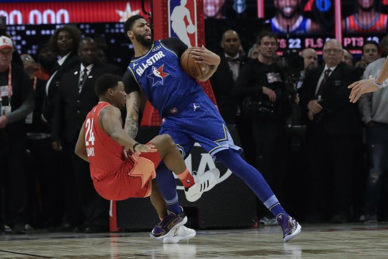 Lakers forward Anthony Davis is fouled by Kyle Lowry late in the All-Star Game on Sunday night. (AP Photo/Nam Huh)