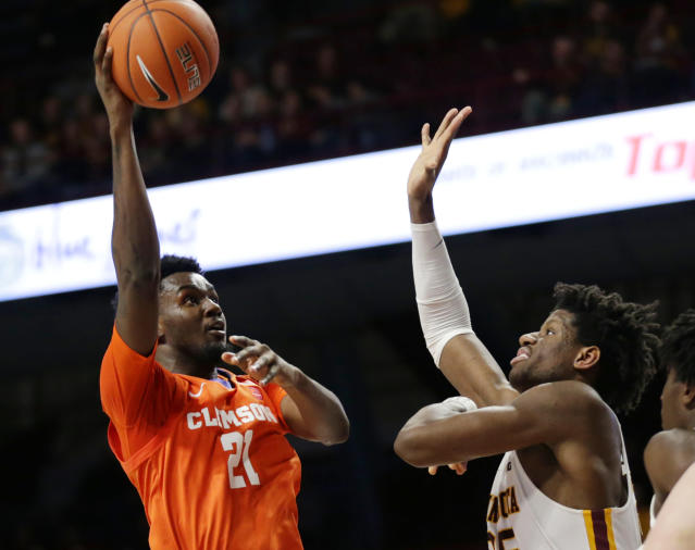 Clemson forward Khavon Moore (2) shoots against Minnesota center Daniel Orturu in the second half during an NCAA college basketball game Monday, Dec. 2, 2019, in Minneapolis. (AP Photo/Andy Clayton-King)