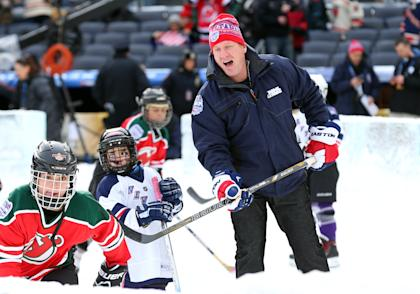 Jan 26, 2014; New York City, NY, USA; NHL former player Jeremy Roenick skates with youngsters on a miniature rink before the Stadium Series hockey game between the New Jersey Devils and the New York Rangers at Yankee Stadium. (Ed Mulholland-USA TODAY Sports)