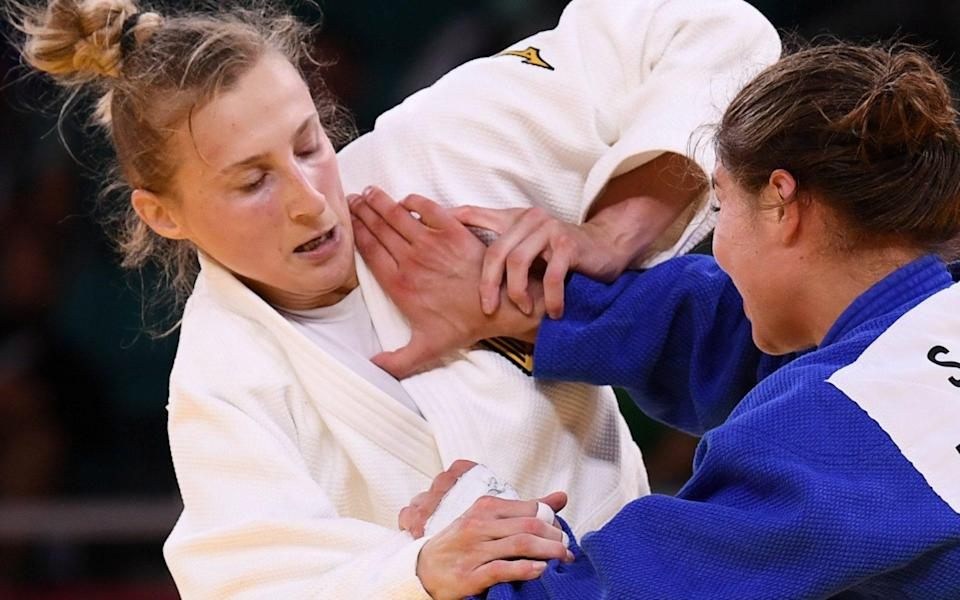 German judoka Martyna Trajdos defends coach who shook and slapped her in pre-bout 'ritual' - REUTERS