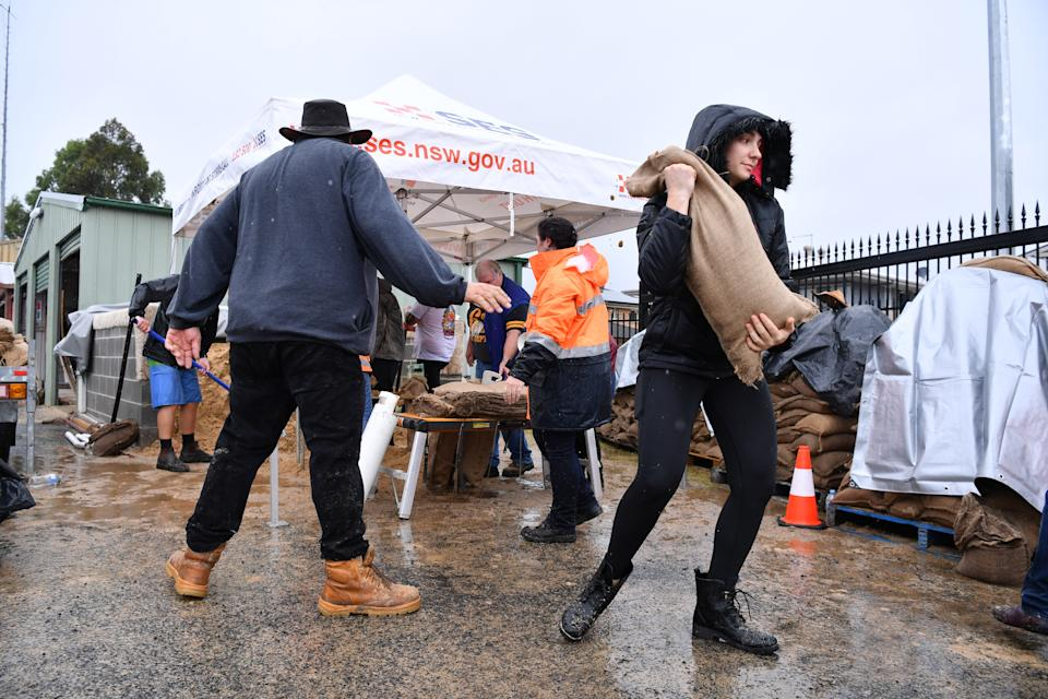 SES volunteers at Penrith SES making and providing free sandbags to residents on Saturday. Source: AAP