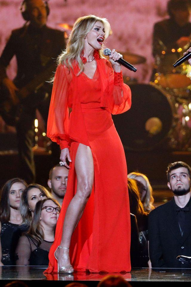 <p>The country singer performed with hubby Tim McGraw at the 2017 CMAs, but it wasn't her singing partner people were talking about. It was her long, glistening leg that was sticking out of her red gown. Twitter enjoyed it and #FaithHillleg was born. (Photo: Getty Images) </p>