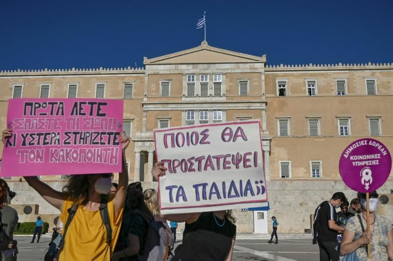 Greek MPs are due to vote on a controversial bill that would grant divorced fathers equal time with their children