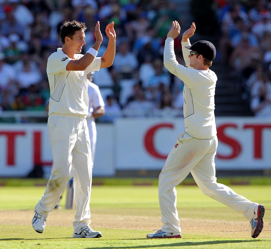 CAPE TOWN, SOUTH AFRICA - JANUARY 02:  Trent Boult (L) of New Zealand celebrates the wicket of Jacques Kallis during day 1 of the 1st Test between South Africa and New Zealand at Sahara Park Newlands on January 02, 2013 in Cape Town, South Africa.  (Photo by Carl Fourie/Gallo Images/Getty Images)