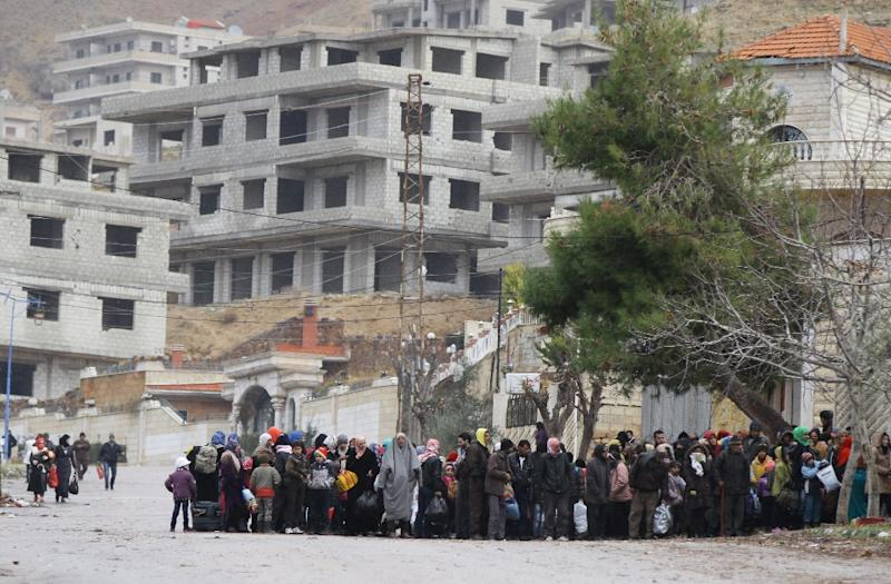Residents of the besieged rebel-held Syrian town of Madaya wait for a convoy of aid from the Syrian Arab Red Crescent on January 14, 2016 (AFP Photo/Louai Beshara)