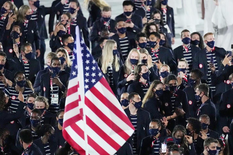 Athletes from the United States of America walk during the opening ceremony in the Olympic Stadium at the 2020 Summer Olympics, Friday, July 23, 2021, in Tokyo, Japan. (AP Photo/David J. Phillip)