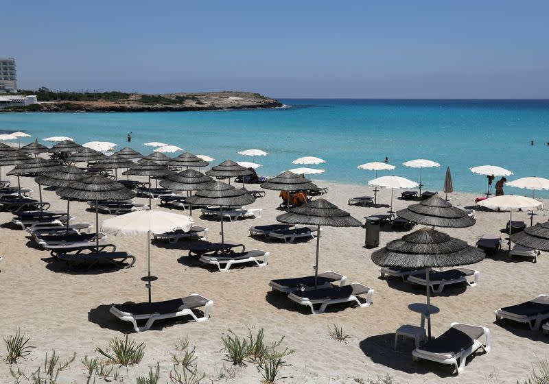 Empty sunbeds are seen at Nissi Beach in the resort of Ayia Napa