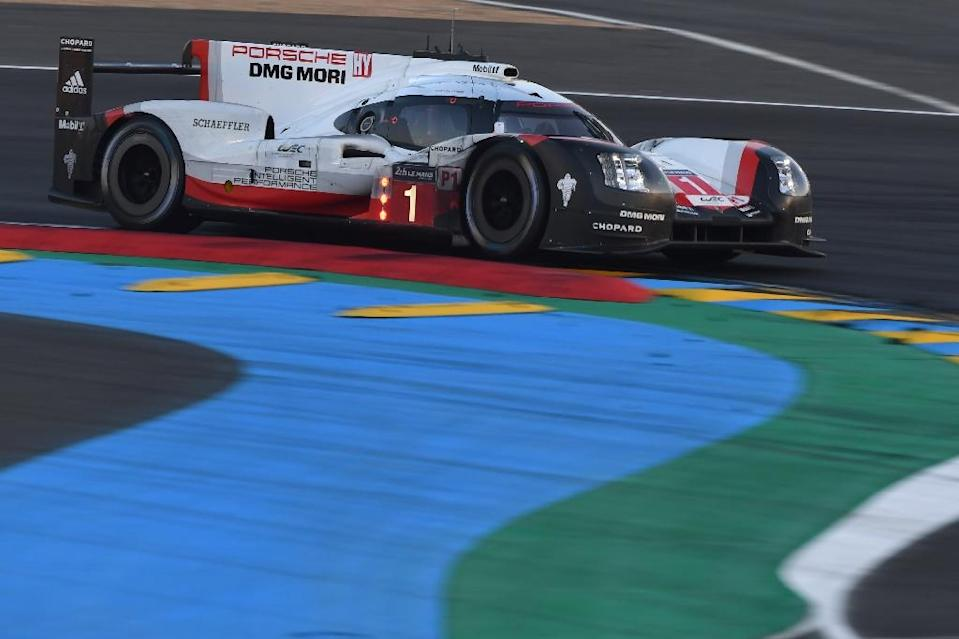 Porsche driven by defending champion Neel Jani, Andre Lotterer and Nick Tandy is left in the lead after Toyota's car limps out of the 24-hour Le Mans race (AFP Photo/JEAN-FRANCOIS MONIER)