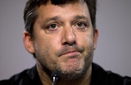 Tony Stewart reads a statement during his return to the track in August. (AP)