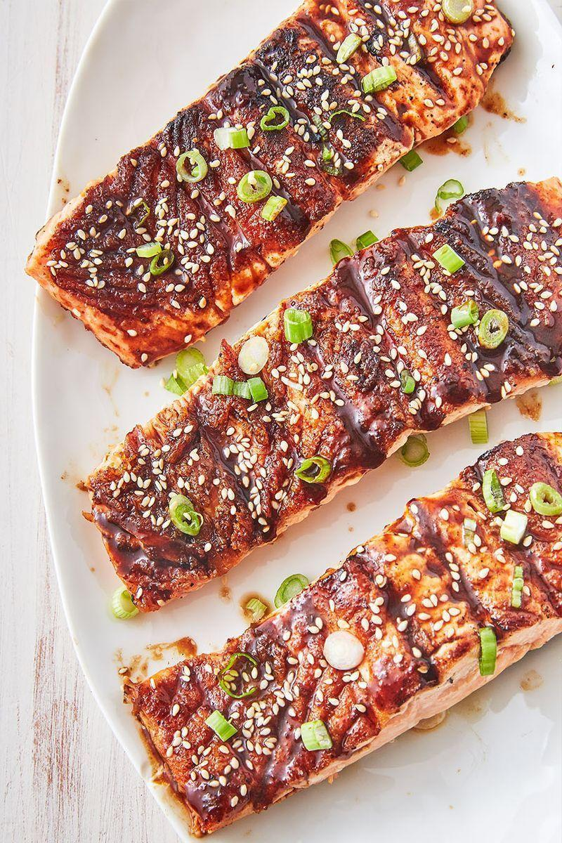 """<p>This easy salmon recipe calls for making a spicy Asian glaze. If you can't find fish sauce, feel free to just leave it out (though it does add a funkiness we love!). As for the mirin (Japanese sweet rice wine), you can substitute dry white wine or rice wine vinegar. </p><p>Get the <a href=""""https://www.delish.com/uk/cooking/recipes/a29205217/best-bbq-salmon-recipe/"""" rel=""""nofollow noopener"""" target=""""_blank"""" data-ylk=""""slk:Asian BBQ Grilled Salmon"""" class=""""link rapid-noclick-resp"""">Asian BBQ Grilled Salmon</a> recipe.</p>"""