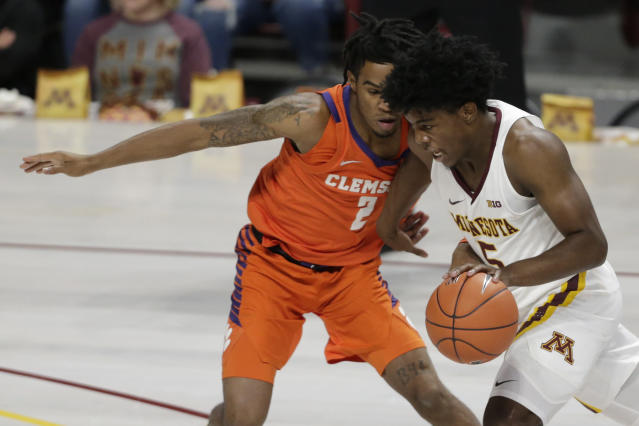 Minnesota guard Hunter Tyson (5) drives against Clemson guard Al-Amir Dawes (2) in the first half during an NCAA basketball game Monday, Dec. 2, 2019, in Minneapolis. (AP Photo/Andy Clayton-King)
