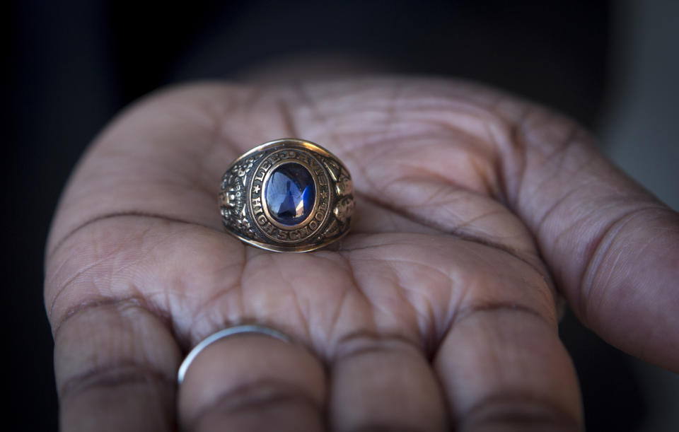 MECHANICSVILLE, VA - MARCH 3, 2018: Nannie R. Davis, 68, holds her class ring from Lee-Davis High School where she graduated from in 1967, in Mechanicsville, Virginia on March 3, 2018. The ring features like likeness of Robert E. Lee and Jefferson Davis and has a confederate flag. Davis wants to see the name of the high school changed. (Photo by Julia Rendleman for the Washington Post)