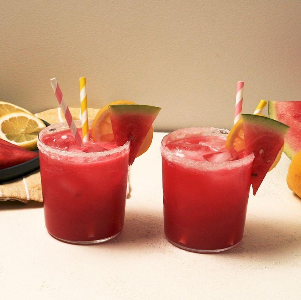 """<p>When the temperature rises, there's something so satisfying about a spiked <a href=""""https://www.delish.com/uk/cocktails-drinks/a33333195/easy-homemade-lemonade-recipe/"""" rel=""""nofollow noopener"""" target=""""_blank"""" data-ylk=""""slk:lemonade"""" class=""""link rapid-noclick-resp"""">lemonade</a>. This version is big on watermelon, our favourite thirst-quenching summer fruit. If you're short on lemons, or want to mix it up, lime juice would also be delicious! </p><p>Get the <a href=""""https://www.delish.com/uk/cocktails-drinks/a33389295/mermaid-lemonade-recipe/"""" rel=""""nofollow noopener"""" target=""""_blank"""" data-ylk=""""slk:Spiked Watermelon Lemonade"""" class=""""link rapid-noclick-resp"""">Spiked Watermelon Lemonade</a> recipe.</p>"""