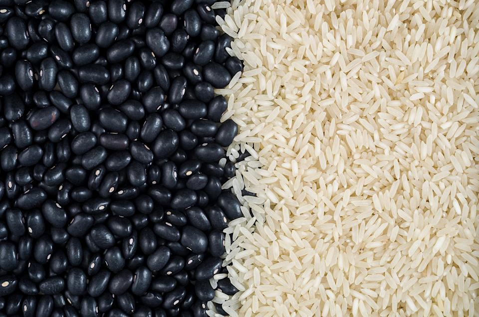 Raw food, raw black beans, vegan, background, texture, raw white rice, beans and rice.