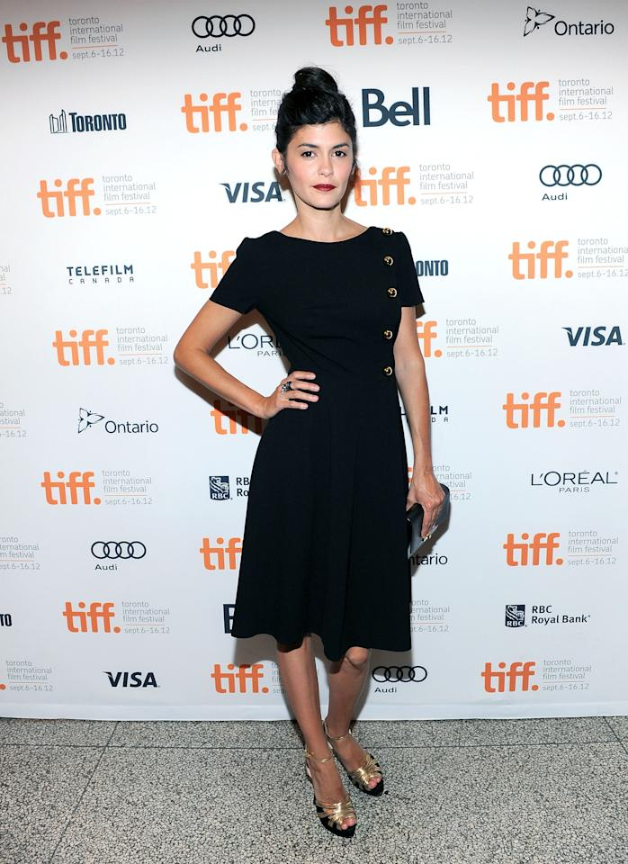 BEST: French actress Audrey Tautou is adorable in this little black dress with button detailing going down the side. We also approve of the chignon on top of her head and the gold-detailed shoes.