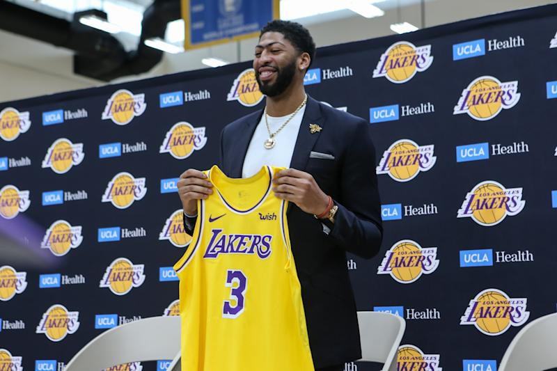 Anthony Davis showing off new #3 jersey during his presentation as a Los Angeles Laker on Saturday. (Getty)