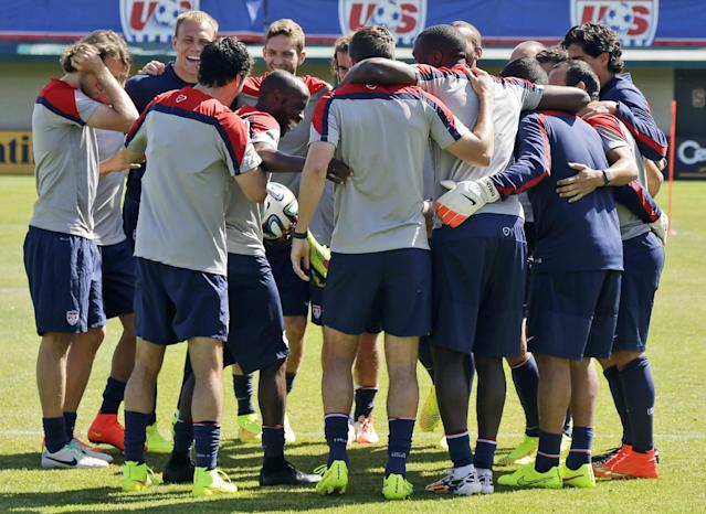 U.S. men's soccer team members embrace during training in preparation for the World Cup, Wednesday, May 21, 2014, in Stanford, Calif. (AP Photo/Marcio Jose Sanchez)