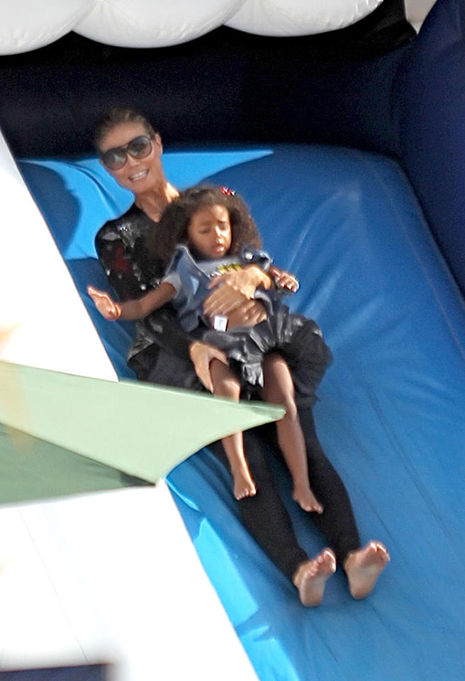 "Halloween lover Heidi Klum held on tight to her daughter Lou as they cruised down the super slide! (10/6/2012)<div style=""display:none;"" class=""skype_pnh_menu_container""><div class=""skype_pnh_menu_click2call""><a class=""skype_pnh_menu_click2call_action"">Call</a></div><div class=""skype_pnh_menu_click2sms""><a class=""skype_pnh_menu_click2sms_action"">Send SMS</a></div><div class=""skype_pnh_menu_add2skype""><a class=""skype_pnh_menu_add2skype_text"">Add to Skype</a></div><div class=""skype_pnh_menu_toll_info""><span class=""skype_pnh_menu_toll_callcredit"">You'll need Skype Credit</span><span class=""skype_pnh_menu_toll_free"">Free via Skype</span></div></div>"