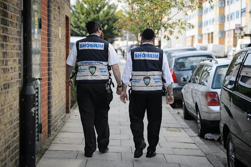 "Members of the Jewish ""Shomrim"" neighbourhood security team pictured in Hackney, northeast London on August 27, 2014"