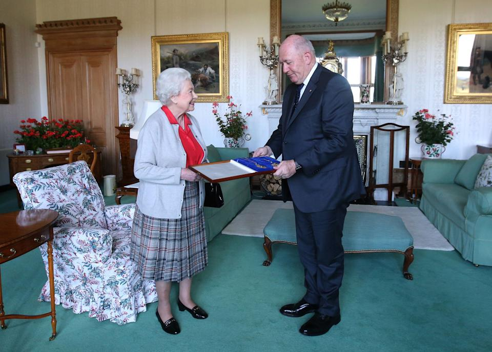 Queen Elizabeth II confers the honour of Knight of the Order of Australia upon His Excellency Sir Peter Cosgrove, the Governor-General of Australia at Balmoral, Scotland.